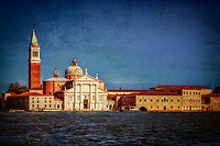 """""""View from the Grand Canal of the church of San Giorgio Maggiore in Venice - Blue""""…<br /> <br /> The first church on the island was built about 790, and in 982 the island was given to the Benedictine order by the Doge Tribuno Memmo. The Benedictines founded a monastery there, but in 1223 all the buildings on the island were destroyed by an earthquake. Andrea Palladio, an Italian Renaissance architect active in the Venetian Republic was commissioned for the rebuild. Palladio, influenced by Roman and Greek architecture, is widely considered to be one of the most influential individuals in the history of architecture, began the rebuild in 1560 and made dramatic improvements. The campanile was rebuilt in neo-classic style and completed in 1791. It was ascended by ramps and now an elevator to the top for panoramic views of Venice. The facade is brilliantly white and represents Palladio's solution to the difficulty of adapting a classical temple facade to the form of the Catholic Basilica. Two very large paintings by Tintoretto relate to the institution of the Eucharist and are located on either side of the presbytery, where they can be seen from the altar rail. """"The Last Supper"""" and """"The Jews in the Desert"""" (collecting and eating the manna, a gift of God to the Israelites in the Desert after they escaped Egypt, which foretells the gift of the Eucharist). Claude Monet painted a series of paintings of the island Monastery of San Giorgio Maggiore in 1908 during the artist's only visit to the city. One of the best known is """"San Giorgio Maggiore at Dusk"""", which exists in two versions. Monet completed his paintings of Venice at home in France and in 1912 showed them in Paris. Buyers included the Welsh collector Gwendoline Davies, who bought three paintings. This vision of the Church of San Giorgio is iconic and famous worldwide. My image capture while upon an evening boat excursion appears theatrical as if the majestic church is posing for yet another Venetian canvas."""