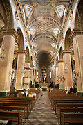 Interior of the Bastia Cathedral in the Citadelle on 16th September 2017 in Bastia, Corsica, France. Bastia is a French commune in the Haute-Corse department of France located in the north-east of the island of Corsica at the base of Cap Corse. Bastia is the principal port and commercial town of the island. The inhabitants of Bastia are known as Bastiais or Bastiaises. Bastia Cathedral Pro-cathédrale Sainte-Marie de Bastia is a former Roman Catholic cathedral in Bastia on the island of Corsica, and a national monument of France. The former Bastia Cathedral, dedicated to Saint Mary, was built from 1495 onwards, with major reconstruction at the beginning of the 17th century. Behind the church stands the chapel of Sainte-Croix, known for its exuberantly decorated interior and for the figure of Christ des Miracles Christ of the Miracles, venerated by the people of Bastia, and discovered floating in the waters of the Mediterranean in 1428.