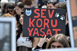 April 28, 2019 - Ankara, Turkey - A demonstrator holds up a placard reading 'Love, protect, keep them alive' during a protest for animal rights. (Credit Image: © Altan Gocher/ZUMA Wire)
