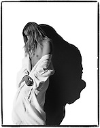 Young woman in white terry cloth bathrobe.