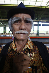 June 1, 2017 - Central Jakarta, Capital Region of Jakarta, Indonesia - An old man passenger holding and kissing the symbol of the state of Indonesia, GARUDA PANCASILA, during the 72nd anniversary of Pancasila as the ideology of Indonesian nation, at Gambir train Station, Jakarta, June 1, 2017. In the commemoration of Pancasila anniversary, the train officers distribute the Garuda Pancasila pin, Red and White Flag, and souvenirs for passengers who memorized Pancasila correctly, this event is part of the effort to instill the spirit of Pancasila to the society. (Credit Image: © Tubagus Aditya Irawan/Pacific Press via ZUMA Wire)