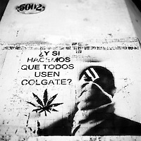 """Translation: """"AND WHAT IF EVERYBODY USES COLGATE""""<br /> <br /> Buenos Aires, Argentina March 2006<br /> Protest, resistance and memory:  The Stencil images in Buenos Aires. <br /> The stencil art takes the streets of the Argentinian capital. Urban artists bomb in silence the city with messages that combine political and social content, imagination and irony.<br /> Photo: Ezequiel Scagnetti"""