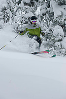 Young man skiing at Kirkwood ski resort near Lake Tahoe, CA.
