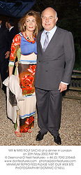 MR & MRS ROLF SACHS at a dinner in London on 20th May 2002.	PAF 99