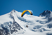 Tandem paragliders soar over Trift Valley, Zermatt, Pennine/Valais Alps, Switzerland, Europe, seen from Berggasthaus Trift (Hotel du Trift). Ideal for hiking in a natural setting, Trift is the only Valley in Zermatt free of railways, lifts or ski runs. From Zermatt, hike the scenic Höhbalmen Höhenweg loop via Bergrestaurant Edelweiss, Trift Hut and Zmutt. With delightful views of the Matterhorn, plus many other peaks and glaciers, this strenuous loop accumulates 1200 meters vertically, up and down over 21.6 km (13.4 miles).