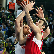 Fenerbahce Ulker's Oguz SAVAS (L) and Olympiacos's Theodoros PAPALOUKAS (R) during their Euroleague Basketball Top 16 Game 5 match Fenerbahce Ulker between Olympiacos at Sinan Erdem Arena in Istanbul, Turkey, Thursday, February 24, 2011. Photo by TURKPIX