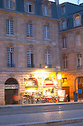 On Les Quais. Night grocery shop. Bordeaux city, Aquitaine, Gironde, France