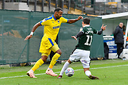 Liam Trotter (14) of AFC Wimbledon is challenged by Ruben Lameiras (11) of Plymouth Argyle during the EFL Sky Bet League 1 match between Plymouth Argyle and AFC Wimbledon at Home Park, Plymouth, England on 6 October 2018.
