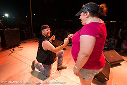 A wedding proposal on stage on Friday at the Smokeout (in 2015,) Rockingham, NC. USA. June 19, 2015.  Photography ©2015 Michael Lichter.