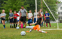 Coach Krhisty and the Division I group look on as Ethan Raphaelson blocks a shot to the goal during On Goal Soccer Camp at Leavitt Park Thursday morning.  (Karen Bobotas/for the Laconia Daily Sun)
