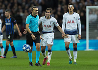 Football - 2018 / 2019 UEFA Champions League - Group B: Tottenham Hotspur vs. Inter Milan<br /> <br /> Harry Winks (Tottenham FC)  appeals to referee Cuneyt Cakir (TUR) after he is penalised for a foul at Wembley Stadium.<br /> <br /> COLORSPORT/DANIEL BEARHAM