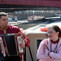 Europe, Russia, St. Petersburg. Russian Folk Music Trio performs on a canal cruise.