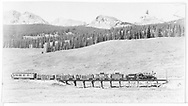 """RGS #74 with Rocky Club railfan outing crossing Bridge 55-A northbound at the Lizard Head Peak viewpoint.  Consist is cabooses #0400 & #0401, three gondolas and business car B-21 """"Edna"""".<br /> RGS  Snow, CO  Taken by Maxwell, John W. - 9/2/1951<br /> In book """"Rio Grande Southern, The: An Ultimate Pictorial Study"""" page 144"""