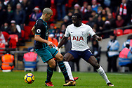 Moussa Sissoko of Tottenham Hotspur (R) takes on Oriol Romeu of Southampton (L). Premier league match, Tottenham Hotspur v Southampton at Wembley Stadium in London on Boxing Day Tuesday 26th December 2017.<br /> pic by Steffan Bowen, Andrew Orchard sports photography.