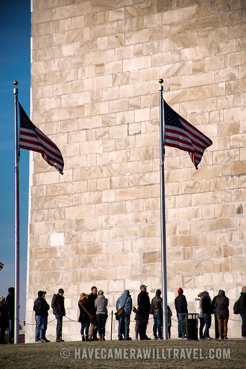 Tourists line up at the base of the Washington Monument. Built to honor George Washington, the country's first president, the 555-foot marble obelisk towers over Washington DC and stands in the center of the National Mall.