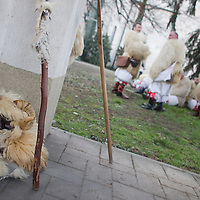 Local people take a break as their traditional buso masks lay on the ground as they celebrate the Buso Carnival in Mohacs (about 200 km South from capital city Budapest), Hungary on February 07, 2016. ATTILA VOLGYI
