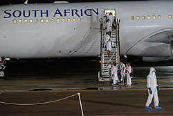 JOHANNESBURG, SOUTH AFRICA - APRIL 26: An SAA flight with a Cuban Health Brigade, consisting of 217 Cuban Health proffesionals who arrived at Waterkloof Airforce Base. on April 26, 2020 in Johannesburg South Africa. Under pressure from a global pandemic. President Ramaphosa declared a 21 day national lockdown extended by another two weeks, mobilising goverment structures accross the nation to combat the rapidly spreading COVID-19 virus - the lockdown requires businesses to close and the public to stay at home during this period, unless part of approved essential services. (Photo by Dino Lloyd)