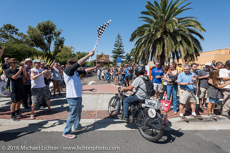 3,400 miles from the Atlantic to the Pacific - The journey is over. Ciro Nisi of Italy riding his class-1, single-cylinder, single speed 1912 Indian crosses the finish line of the Motorcycle Cannonball Race of the Century. Stage-15 ride from Palm Desert, CA to Carlsbad, CA. USA. Sunday September 25, 2016. Photography ©2016 Michael Lichter.