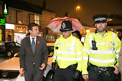 © Licensed to London News Pictures. 03/11/2015. Alum Rock, Birmingham, UK. Shadow Home Secretary ANDY BURNHAM visiting Alum Rock in Birmingham to launch the Labour Policy on Policing. Pictured, ANDY BURNHAM, left, talking to Sgt IFTI ALI, centre and Inspector CHRIS SMITH, right on the Alum Rock Road. Photo credit : Dave Warren/LNP