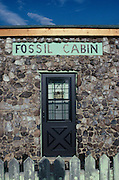 Billed as the world's oldest house, a fossil shop near Bone Cabin Quarry is constructed of Jurassic dinosaur bones about 145 million years old.