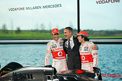 """© London News Pictures. 31/01/2013 . Woking, UK.  Team McLaren Mercedes drivers Jenson Button (left) and Sergio """"Checo"""" Perez (right) with team principal of Vodafone McLaren Mercedes Martin Whitmarsh (centre) at  the unveiling of the new MP4-28 Formula 1 car at the McLaren Technology Centre in Woking, Surrey, UK on  Thursday, Jan. 31, 2013. Photo credit : Ben Cawthra/LNP"""