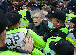 © Licensed to London News Pictures; 14/11/2020; Bristol, UK. Police arrest PIERS CORBYN who was due to be the main speaker at an Anti-Lockdown protest march and rally by Stand Up Bristol and StandUpX2, against the Covid-19 lockdown during the coronavirus pandemic, taking place on College Green and in Bristol city centre. Protests have been declared illegal under the current Covid-19 lockdown as people are not allowed to meet in more than groups of two and police have threatened arrests and fines against those attending. Police arrested several people. The protest is against Lockdowns, Isolation of the Elderly, Ruined Childhoods, Business Closures, Masks, Government Interference in Private Life and is part of a series of protests today in Sheffield, Wolverhampton, Portsmouth, Bristol and Bournemouth. England is under a national lockdown, sometimes known as lockdown 2.0, as the UK Government tries to stop the spread of the covid-19 coronavirus pandemic. From 05 November lockdown restrictions came into force across England with all pubs, bars, restaurants and entertainment venues shut as well as all non-essential shops. People have been told to stay at home except for work, education, exercise or essential shopping and each person can only meet one other person from outside their household in an outdoors public space. Photo credit: Mark Simmons/LNP.