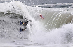 May 13, 2019 - Newport Beach, California, U.S. - A bodyboarder gets wrapped up in a wave at the Wedge in Newport Beach, CA on Monday, May 13, 2019. Waves in the 10-12 foot range were starting to hit and expected to continue for the next couple days, according to Surfline. (Credit Image: © Paul Bersebach/SCNG via ZUMA Wire)
