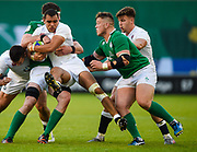 England centre Joe Marchant is held by  Ireland second-row Sean O'Connor during the World Rugby U20 Championship Final   match England U20 -V- Ireland U20 at The AJ Bell Stadium, Salford, Greater Manchester, England onSaturday, June 25, 2016. (Steve Flynn/Image of Sport)
