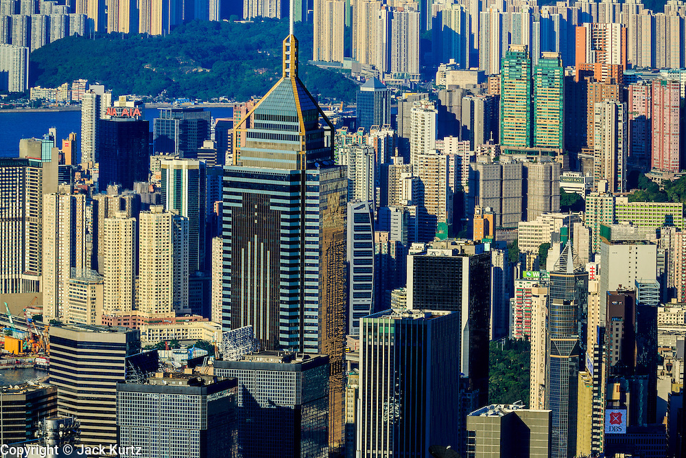 11 AUGUST 2013 - HONG KONG: Skyscrapers in Hong Kong as seen from Victoria Peak. Hong Kong is one of the two Special Administrative Regions of the People's Republic of China, Macau is the other. It is situated on China's south coast and, enclosed by the Pearl River Delta and South China Sea, it is known for its skyline and deep natural harbour. Hong Kong is one of the most densely populated areas in the world, the  population is 93.6% ethnic Chinese and 6.4% from other groups. The Han Chinese majority originate mainly from the cities of Guangzhou and Taishan in the neighbouring Guangdong province.      PHOTO BY JACK KURTZ