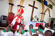 Led by Bishop Emmanuel Makala (standing), 21 new pastoral candidates are ordained in a service with more than 1,000 worshippers on Sunday, March 15, 2015, at the Evangelical Lutheran Church in Tanzania – South-East of Lake Victoria Diocese's (ELCT-SELVD) Ebenezer Cathedral in Shinyanga, Tanzania. LCMS Communications/Erik M. Lunsford
