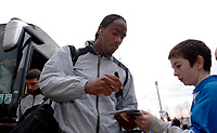 Photo: Daniel Hambury.<br />Reading v Cardiff City. Coca Cola Championship.<br />02/01/2006.<br />Cardiff's Cameron Jerome signs an autograph as he arrives at the game.