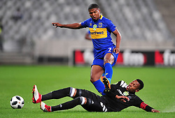 Cape Town 180314.Cape Town City winger Lyle Lakay  tackled by Happy Jele of Orland Pirates in  aNedbank  geme taking place at the Cape Town Stadium. Photograph:Phando Jikelo/AFRICAN NEWS AGENCY/ANA