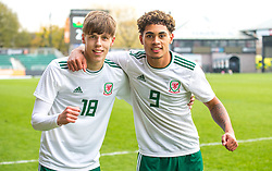 NEWPORT, WALES - Tuesday, November 19, 2019: Wales' Rhys Hughes and Christian Nortons celebrate after Wales beat Kosovo 2-0 in the second goal with Ryan Astley and other teammates during the UEFA Under-19 Championship Qualifying Group 5 match between Kosovo and Wales at Rodney Parade. (Pic by Laura Malkin/Propaganda)