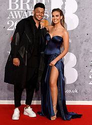 February 21, 2019 - London, London, United Kingdom - Image licensed to i-Images Picture Agency. 20/02/2019. London, United Kingdom.  Little Mix's Perrie Edwards  with her boyfriend Alex Oxlade-Chamberlain, at the Brit Awards in London. (Credit Image: © i-Images via ZUMA Press)