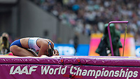 Athletics - 2017 IAAF London World Athletics Championships - Day Two (AM Session)<br /> <br /> Event: High Jump Women - Heptathlon<br /> <br /> Katarina Johnson-Thompson (GBR)collapses into the mat after she is eliminated from the high jump competition  <br /> <br /> COLORSPORT/DANIEL BEARHAM