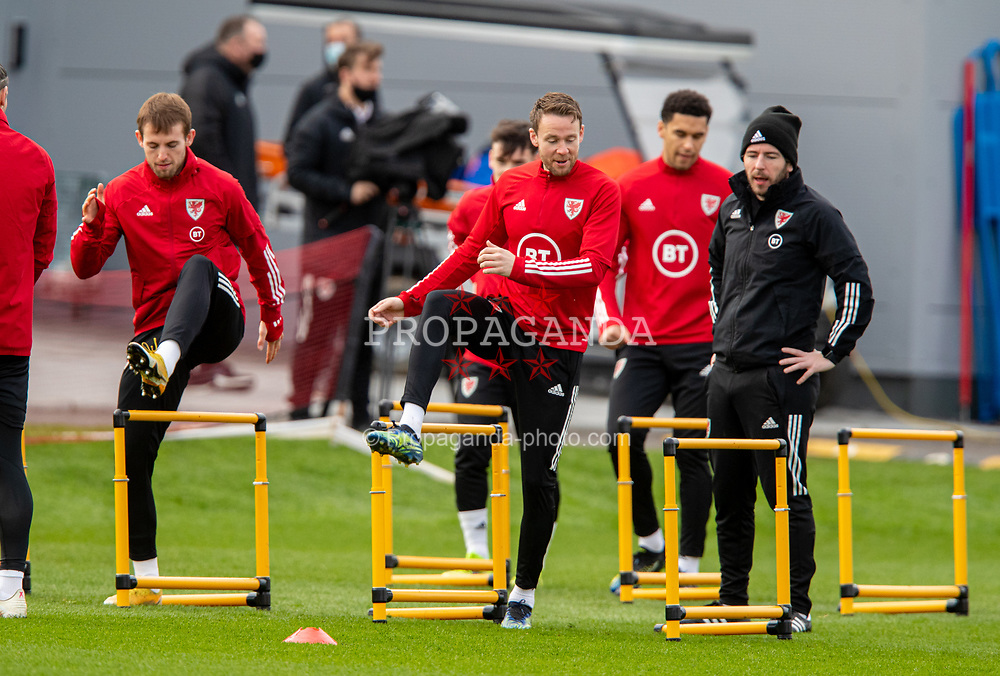 CARDIFF, WALES - Monday, March 29, 2021: Wales' Rhys Norrington-Davies (L) and Chris Gunter (R) during a training session at the Vale Resort ahead of the FIFA World Cup Qatar 2022 Qualifying Group E game against the Czech Republic. (Pic by David Rawcliffe/Propaganda)