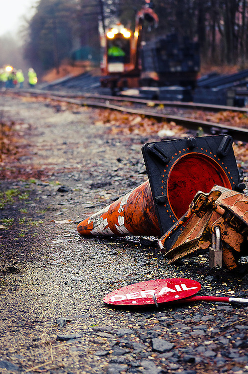 A bevy of crew teams and equipment work systematically replacing railroad ties along a relatively long stretch of tracks in Gloucester County in New Jersey.