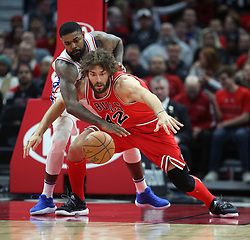 December 18, 2017 - Chicago, IL, USA - Chicago Bulls center Robin Lopez (42) battles Philadelphia 76ers forward Amir Johnson (5) for a loose ball during the first half of an NBA basketball game at the United Center in Chicago on Monday, Dec. 18, 2017. The Bulls won, 117-115. (Credit Image: © Terrence Antonio James/TNS via ZUMA Wire)