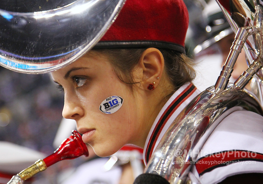Dec. 03, 2011; Indianapolis, IN, USA; Member of the Wisconsin Badgers marching band waits to take the field before the game against the Michigan State Spartans at Lucas Oil Stadium. Mandatory credit: Michael Hickey-US PRESSWIRE