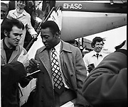 Pelé signs autographs on the tarmac at the Dublin airport..May 1979