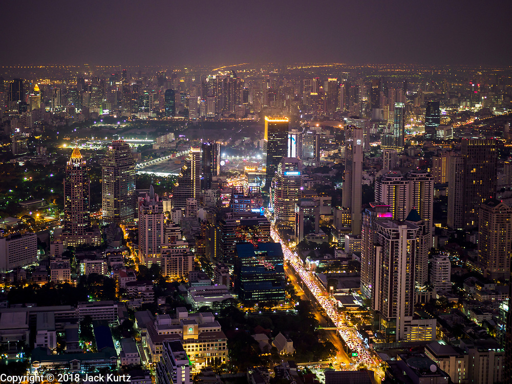 27 DECEMBER 2018 - BANGKOK, THAILAND: Looking north from the rooftop observation deck of the King Power Maha Nakhon Tower. The MahaNakhon Skywalk, at the top of the King Power Maha Nakhon Tower, is 1,030 feet (314 meters) above street level. It is the tallest building and highest vantage point in Bangkok. The skywalk opened in November and has been drawing large crowds.    PHOTO BY JACK KURTZ