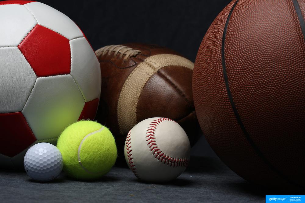 A studio shot of a Baseball, a Basketball an American Football, a soccer ball, a golf ball and a tennis ball. 20th October 2012. Photo Tim Clayton