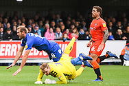 AFC Wimbledon Forward James Hanson (18) clashes with Wycombe Wanderers Goalkeeper Ryan Allsop (1) and is awarded a penalty during the EFL Sky Bet League 1 match between AFC Wimbledon and Wycombe Wanderers at the Cherry Red Records Stadium, Kingston, England on 27 April 2019.
