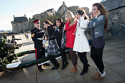 Miss Scotland Jennifer Reochs with Gunner Jamie Shannon. With Miss Wales Sara Jessica Manchipp, Miss England Alize Lily Mounter and Miss Northern Ireland Finola Frances Guinnane and Miss Ireland Holly Carpenter..The Miss World participants visit Edinburgh Castle and will witness the firing of the One O'clock gun..MISS WORLD 2011 VISITS SCOTLAND..Pic © Michael Schofield.
