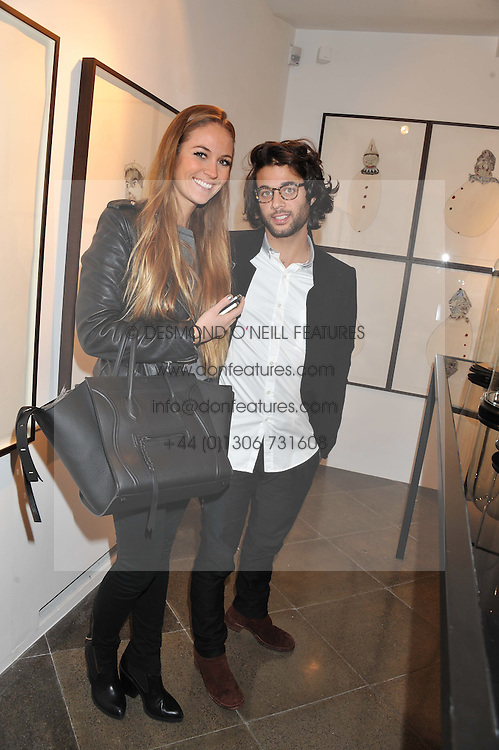 BENJAMIN KHALILI and PAULINE ROSENBLAT at a private view of jewellery by Eugenie Nairchos and Noor Fares entitled Galactic Garden held at Shizaru Mayfair, 112 Mount Street, London on 5th December 2012.