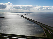 Nederland, Friesland, Gemeente Wonseradeel, 28-04-2010; begin van de Afsluitdijk vanuit Friesland, met Kornwerderzand, gezien naar het westen. Noordhollandsche kust zichtbaar aan de horizon, 32 kilometer verder. Waddenzee rechts, IJsselmeer links. Aanleg van de dijk vormde onderdeel Zuiderzeewerken, initiatief van ingenieur Cornelis Lely..Enclosure Dam from the coast of Friesland, with Kornwerderzand, seen west, North-Holland at the horizon (32 kilometers away). Construction of the dam was part of the Zuiderzee Works, an initiative of engineer Cornelis Lely. IJsselmeer lake (left), the Wadden Sea (right)..luchtfoto (toeslag), aerial photo (additional fee required).foto/photo Siebe Swart