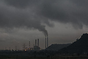 October 2013. Singrauli. One of many power plants pumping out smoke, which can spread pollution as far as 400 km away, choking communities below. Scientists estimate that in 2011-2012, air pollution from coal fired power plants was responsible for 80,000-115,000 premature deaths, bronchitis, respiratory symptoms, heart problems and 20.9 million asthma attacks.