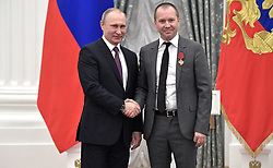 May 24, 2017 - Moscow, Russia - May 24, 2017. - Russia, Moscow. - Russian President Vladimir Putin and Evgeny Mironov (right), artistic director of the Theatre of Nations, at the ceremony to present state awards in science, culture, healthcare, sports and manufacturing to outstanding Russians. The Kremlin's Catherine Hall. (Credit Image: © Russian Look via ZUMA Wire)