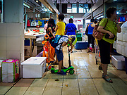11 DECEMBER 2018 - SINGAPORE:  Shoppers in the Haig Road Market and Food Centre in the Geylang neighborhood. The Geylang area of Singapore, between the Central Business District and Changi Airport, was originally coconut plantations and Malay villages. During Singapore's boom the coconut plantations and other farms were pushed out and now the area is a working class community of Malay, Indian and Chinese people. In the 2000s, developers started gentrifying Geylang and new housing estate developments were built.     PHOTO BY JACK KURTZ