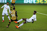 Tammy Abraham of Swansea city shoots wide of goal as  Federico Venancio of Sheffield Wednesday blocks.  The Emirates FA Cup, 5th round replay match, Swansea city v Sheffield Wednesday at the Liberty Stadium in Swansea, South Wales on Tuesday 27th February 2018.<br /> pic by  Andrew Orchard, Andrew Orchard sports photography.